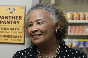 Della Hudson smiling in the Panther Pantry at Adelphi.