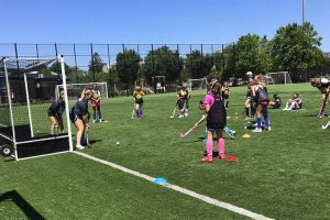 While at Adelphi University, campers are placed into small groups to work on their field hockey fundamentals.