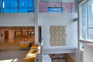 Acoustic panel and seating on the wall in the UC main lobby