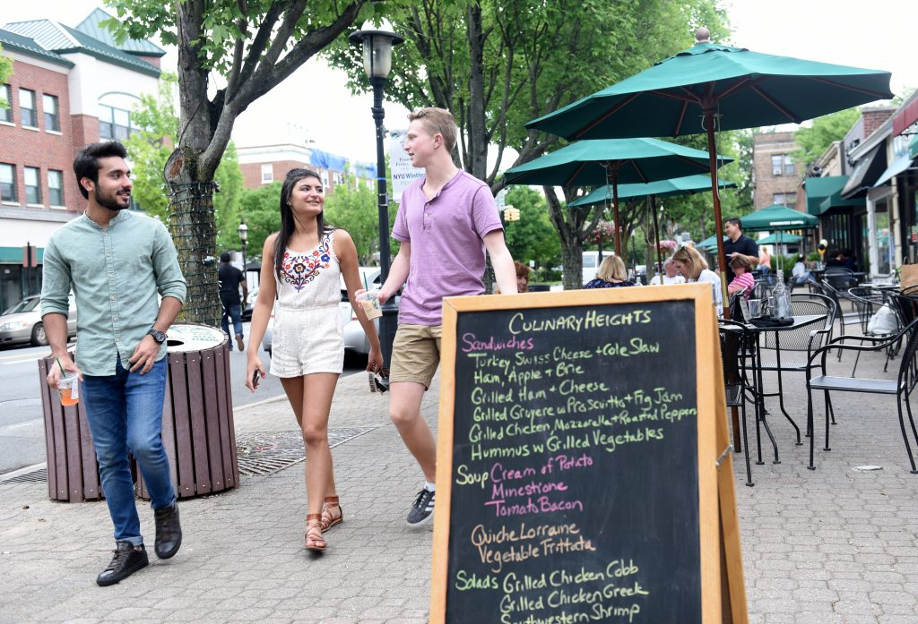 Adelphi students stroll 7th street in Garden City.