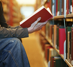 Student reading book in the library