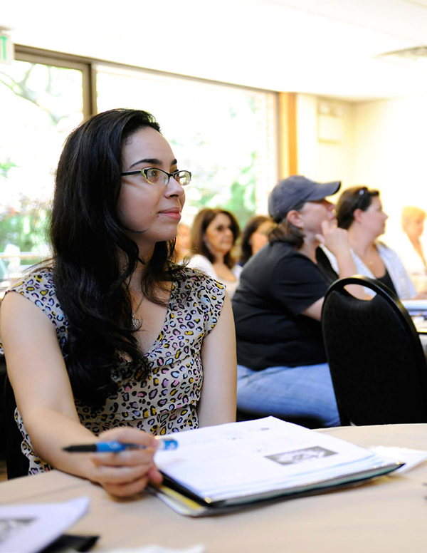 Adelphi female student listens to lecture
