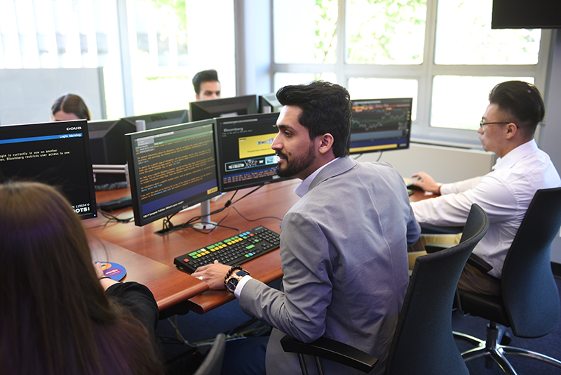 Adelphi business students working in the trading room.