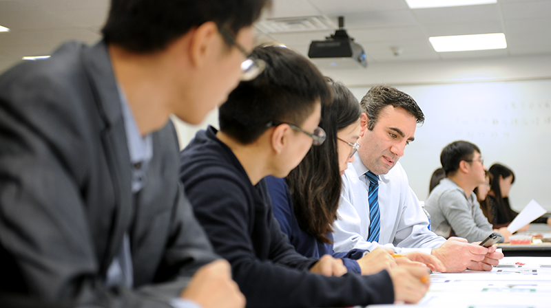 Adelphi Management students collaborate in the classroom.