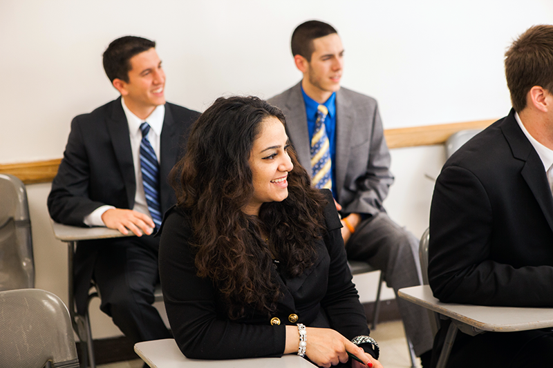 Adelphi business students focused in the classroom.