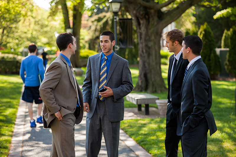 Business students talk on Adelphi campus.