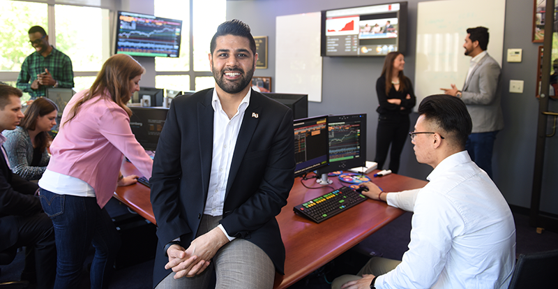 MBA student smiles in trading room