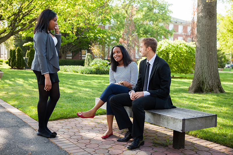 Business students talk outside on Adelphi's campus