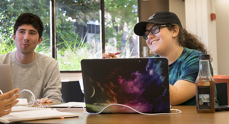 Adelphi students discuss research at the Swirbul Library