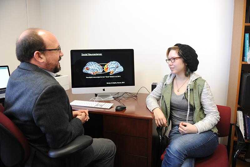 Adelphi neuroscience student talking to faculty