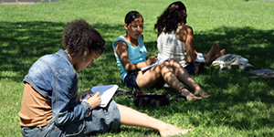 Alice Hoffman Young Writers Retreat students sitting on grass