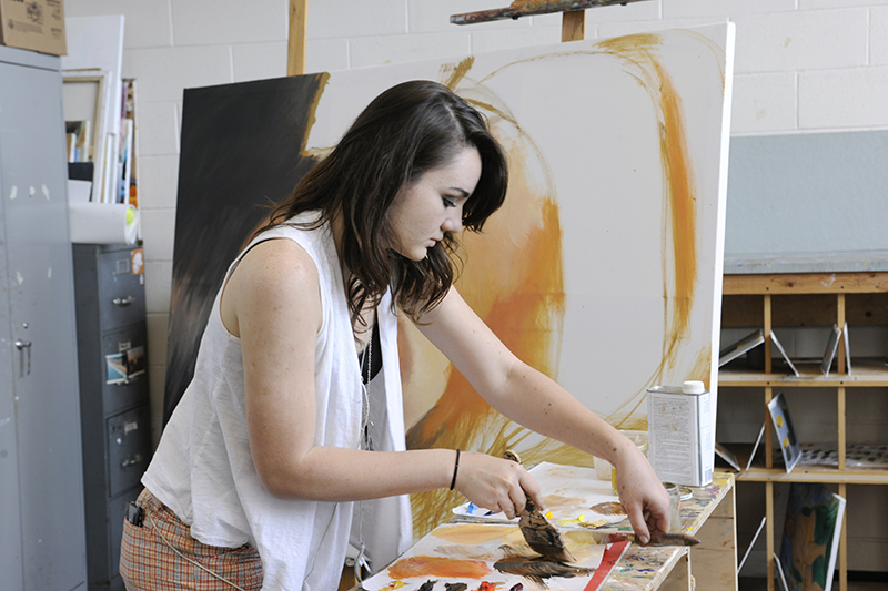 Painter in the FAF painting studio at Adelphi