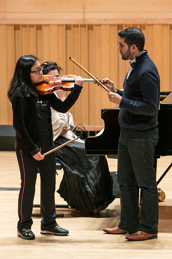 music instructor at Adelphi working with violin student