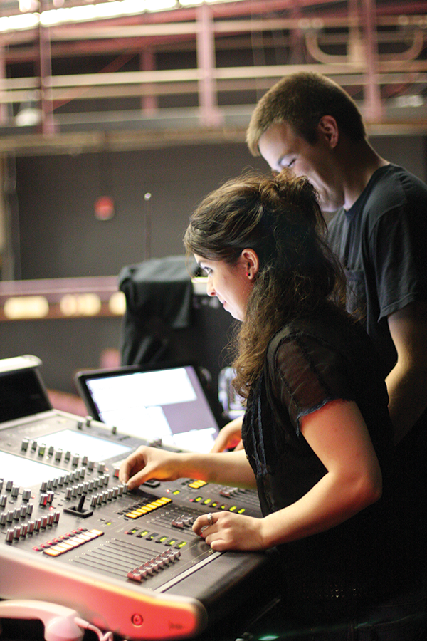Adelphi theatre technology students working on sound board.