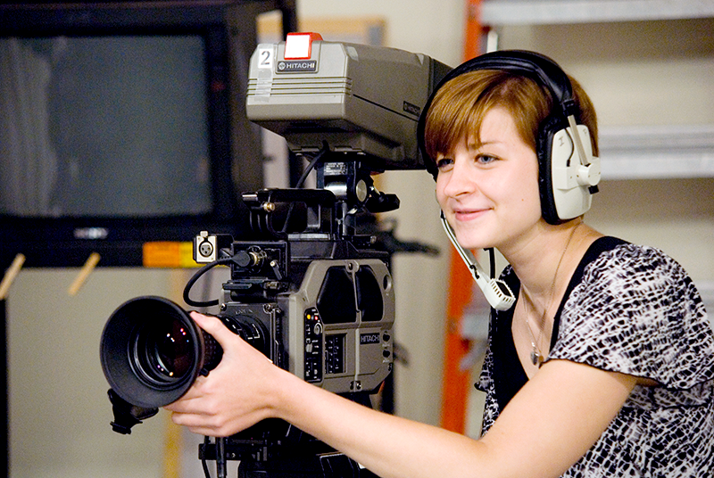 Adelphi student using professional video camera