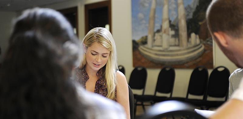 Adelphi student studying in Alumni House main room