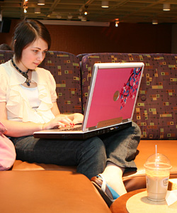 Student using laptop in the Underground Cafe