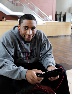 Student using an mobile device in the Center for Recreation and Sports
