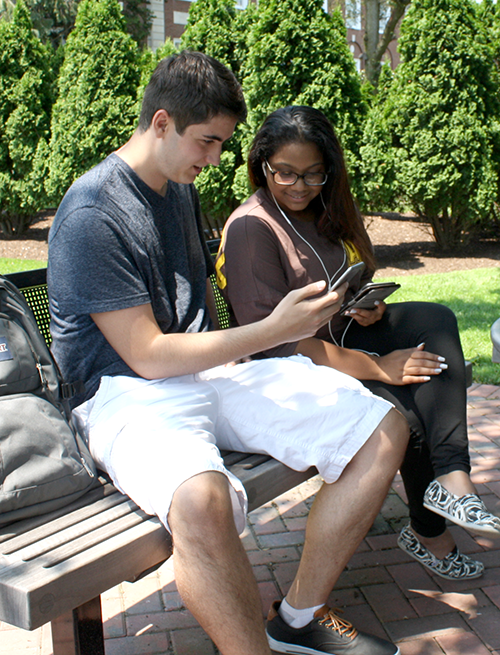 Adelphi students using AU2go mobile app on campus