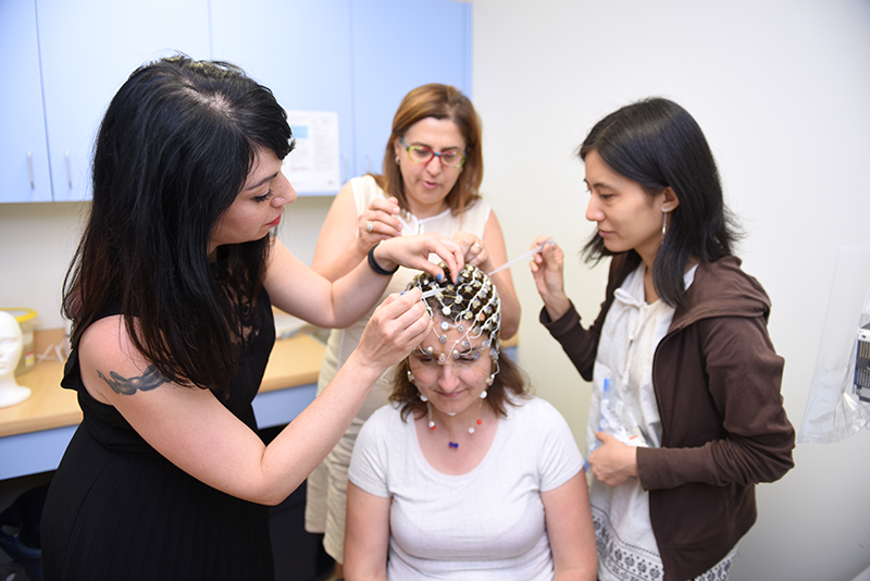Communication disorders students at Adelphi place sensors on a patient