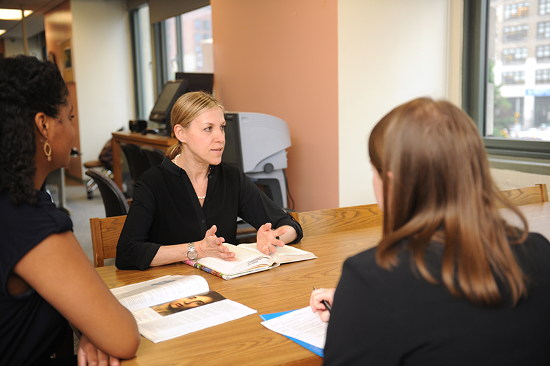 Adelphi Social work discussion around a table