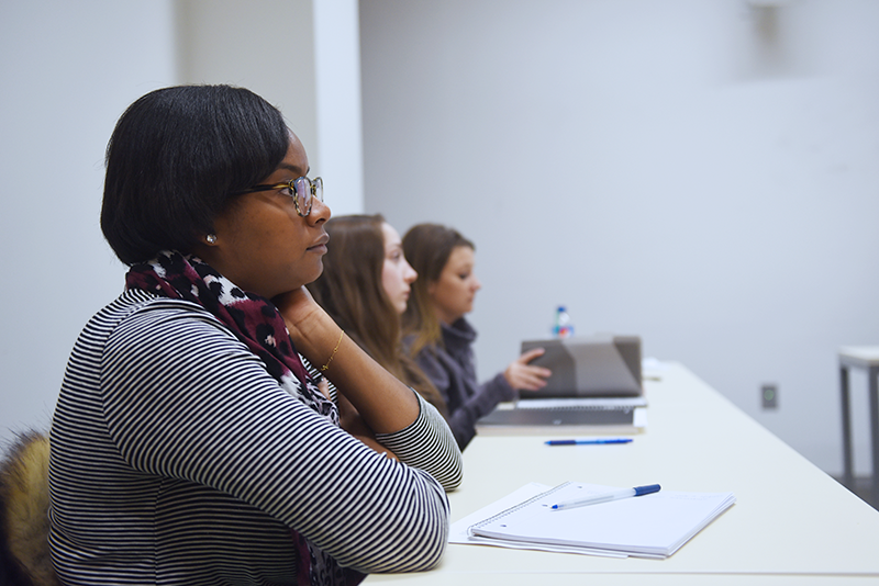 Inside a social work classroom students are focused