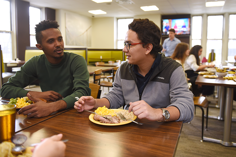 Dining at Adelphi University two students share a meal