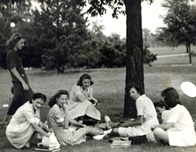 Joyce Ostrowski (née Hollister) '46 with classmates on the lawn