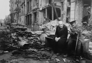Two elderly German men sitting among the rubble of the Battle of Berlin in May of 1945.