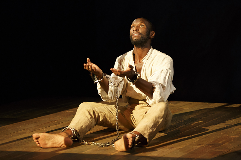 Nat Turner in Jerusalem NYTW By Nathan Alan Davis Directed by Megan Sandberg-Zakian Scenic Design by Susan Zeeman Rogers Costume Design by Montana Blanco Lighting Design by Mary Louise Geiger Sound Design by Nathan Leigh Fight Direction by Thomas Schall Dialect Coach Dawn-Elin Fraser Stage Manager Shelley Miles Featuring Phillip James Brannon and Rowan Vickers