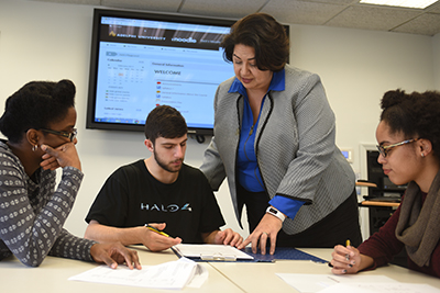 Nathalie Zarisfi works with students