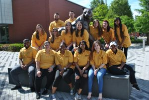 Commuter assistants sitting outside Center for Recreation and Sport building.