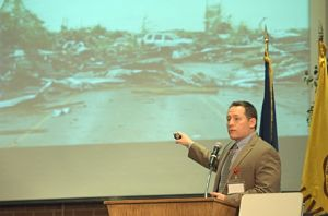 Dr. D. Sean Smith shows photo of tornado ravaged Joplin, MO from 2011.