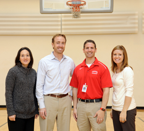 Joining forces to improve the health and fitness of public school students in Freeport are (from left to right) Anne Gibbone, Ed.D., Kevin Mercier, Ed.D., Freeport High School athletics director Jonathan Bloom, M.A. '00, and Kadi Bliss, Ph.D.