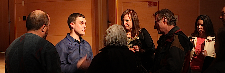 Greg Williams, center, and Audrey Freshman, right, met with audience members after the event.