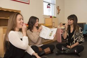 Student-clinicians Rebecca Nuzzi, Amanda Castellano and Rachel Fernandes teaching toddlers in TOTalk.