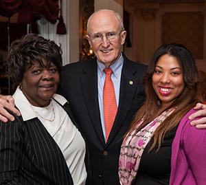 L'Leshia Stevens and Marie Nichols with President Dr. Robert A. Scott