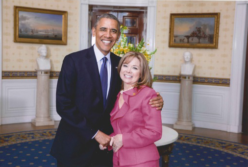 Marguerite Izzo, M.S. '84, with President Barack Obama at the White House.