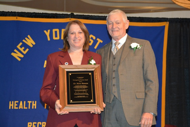 Dr. Manson accepts her award from NYS AHPERD president Rod Mergardt.