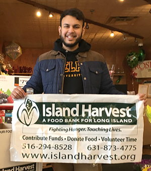 Adelphi student involved with Island Harvest