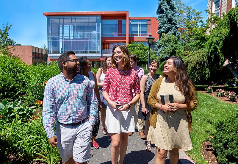 Adelphi students walking in in front of the Nexus Building.