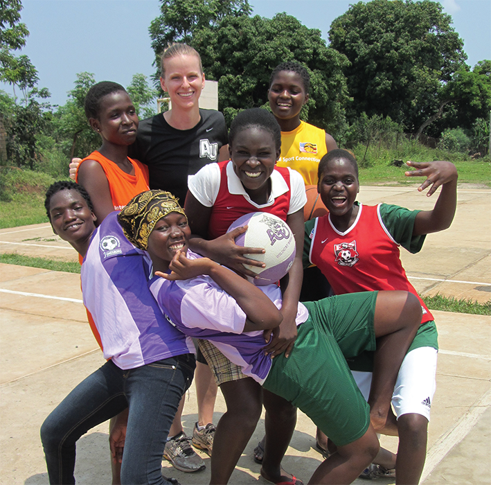 Meredith Whitley, Ph.D., (center) collaborated with Alisha Johnson, M.S., at the University of Tennessee, Knoxville, (not pictured) and community leaders in Uganda to evaluate and expand sports opportunities for girls.