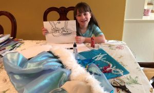 Sienna Leaver shows off her bra design for the Creative Cups Auction at Adelphi University