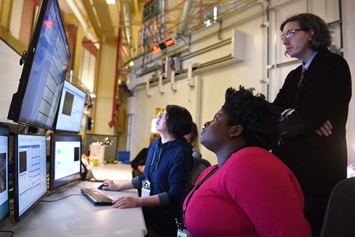 Assistant Professor Ivan Fabe Dempsey Hyatt, Ph.D., and Adelphi student Marly Medard, accompanied by her crystal sample, arrived to work on a beamline of the synchrotron.