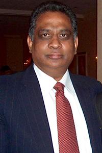 Headshot of Leonard Achan Senior