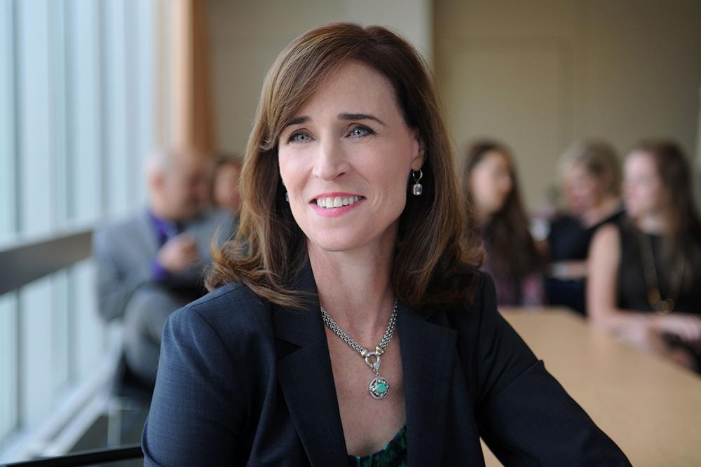 President Dr. Christine Riordan-