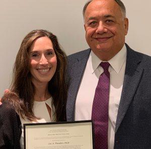 Lea A. Theodore, PhD and Visitng Professor Receiving Award