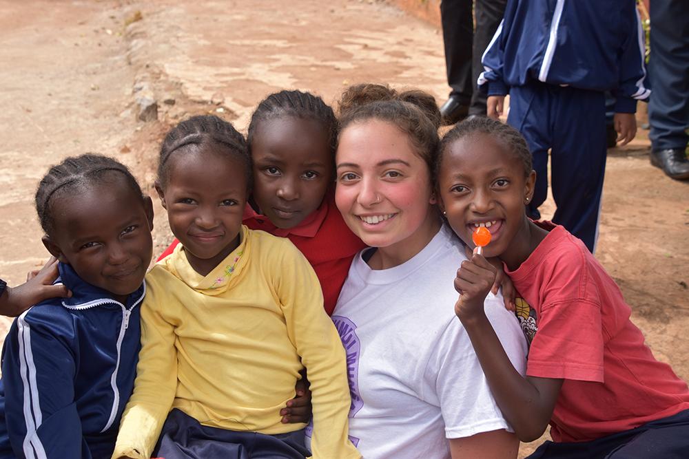 Adelphi Student with Children in Kenya