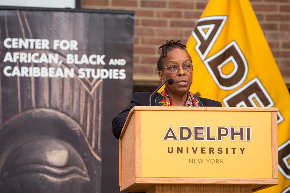 A woman speaking at Adelphi