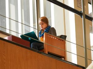 A student in the Swirbul Library using a laptop.